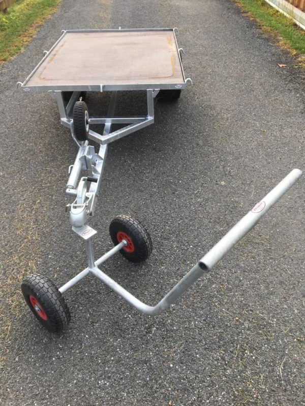 Trolley puller with small flat bed trailer